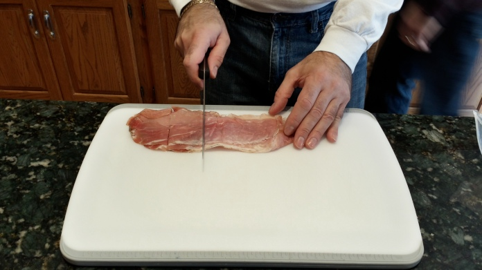 The Don cutting the prosciutto into little bites