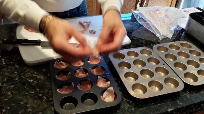 The Don placing the prosciutto into mini muffin tins