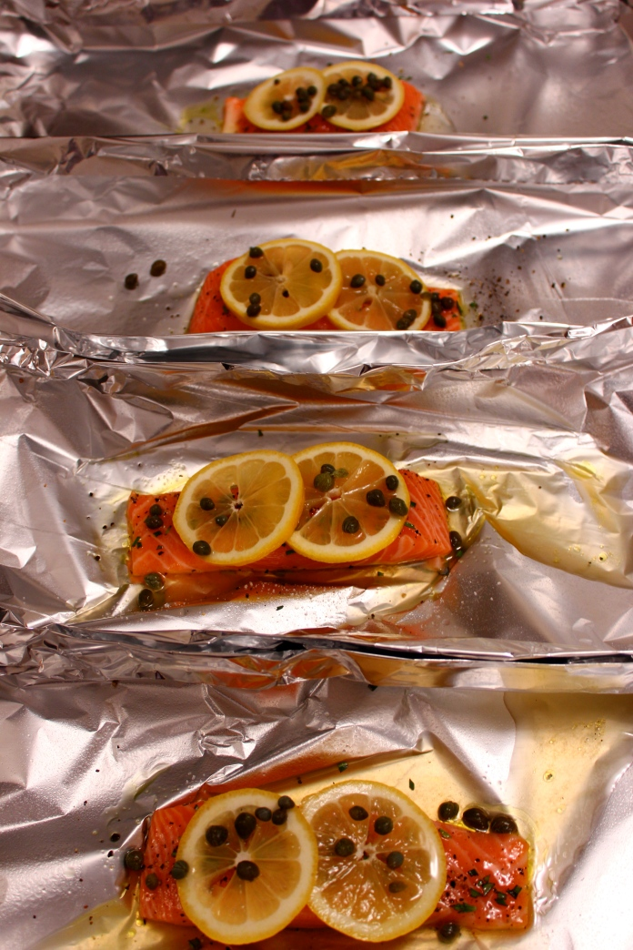 Salmon with Lemon, Capers and Rosemary - topping each filet with 2 lemon slices, lemon juice, wine and capers