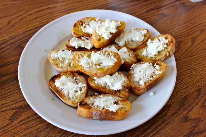 Goat Cheese atop Grilled Baguette Slices    www.morewinelesswhines.com